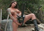 Dangerous busty tattoo beauty with chainsaw.