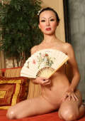 Oriental girl with big boobies and very long hairs striping