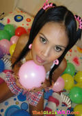 Asian model posing and playing withbaloons