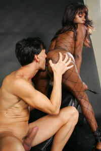 Black Tranny in fishnet anal action