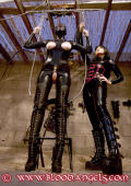 Extreme high boots for two latex girls.