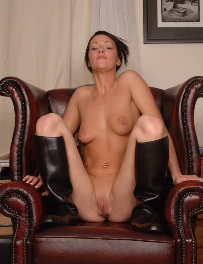 Nude girl posing in riding boots