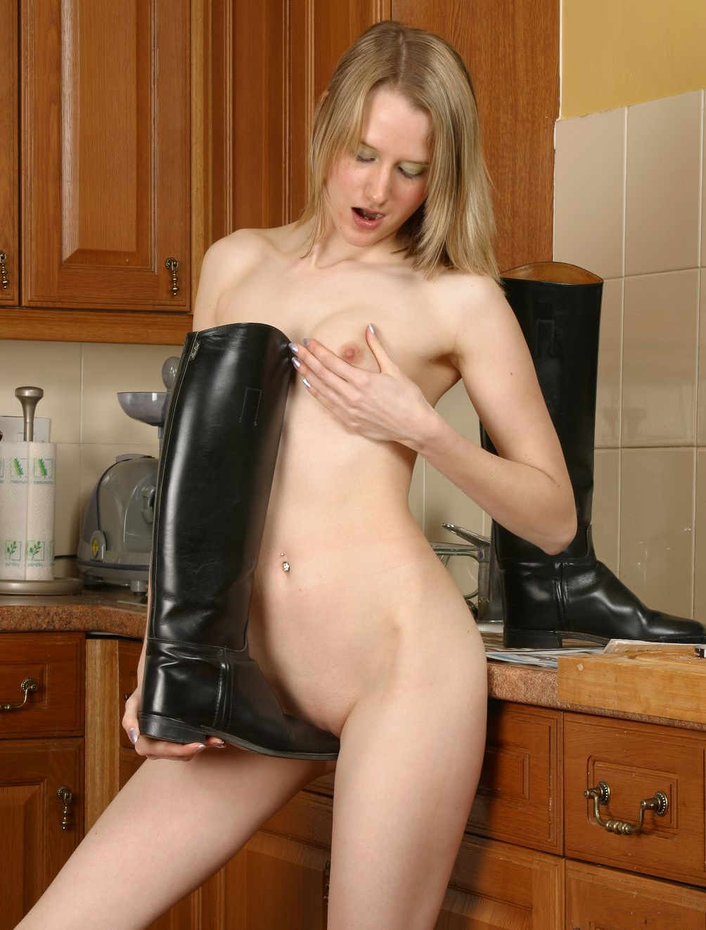 Young blond girl with black boots