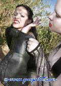 kinky fetish girl outdoor bound tight in leather