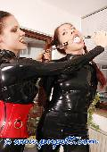 ponygirl and mistress dressed in red and black latex 7