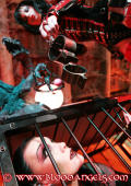 Caged Slavegirl and her dominant BLOODANGEL in the dungeon.