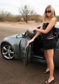 Carmen strips down on her car