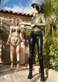 Slavegirl in chains and chustitybelt outdoor.