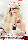 Blonde curly haired Latex nurse in medical fetish action