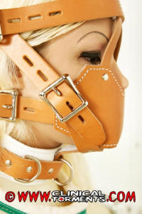 Restrained girl with headgear