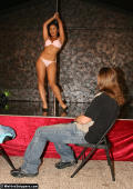 Stripgirl dancing on pole