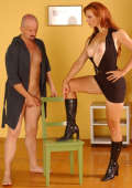 Redhead Amazon Mistress dominates her slave