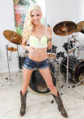 Drummer girl strips and spreads