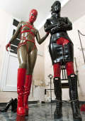 Masked bound and chained girl
