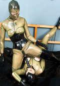 Two Latexgirls play with big black dildo