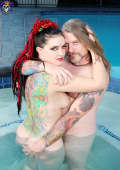 Tattooed couple fucking in the hot tub