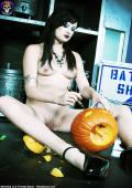 Naked Goth Babe Carving Halloween Pumpkin
