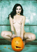 Classic Gothic Halloween Pin-up Babe with her Pumpkin.