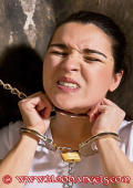 Slavegirl Angel in handcuffs and chains in the dungeon