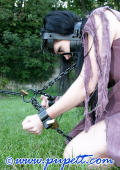 Chained and cuffed prision girl.