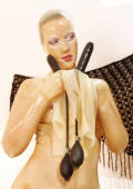 Latex slavegirl gets her holes pluged with big pump up dildos.