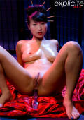 Sharon Lee toying, playing with oil and peeing as a sexy geisha.