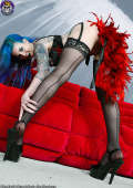 Tattooed Seductress Teasing in Heels and Stockings