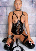 Hot bitch in latex plays with dildo