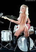 Female Rock star in shiny high heel boots