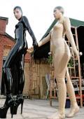 Girlfriends in latex enjoy a kinky weekend.