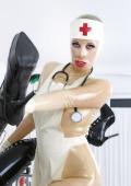 Fetish nurse Pupett with female patient.
