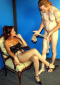 Domina in pantyhose and slave