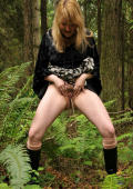 Busty black Trixie pees in the woods.