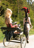 Outdoor ponygirl action.