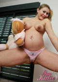 Pregnant teen loves to play with her Teddy bear