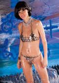 Slim girl with oiled body and metal bikini