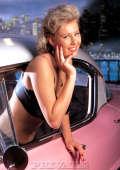 Blond milf in retro car