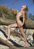 Thin bitch posing nude