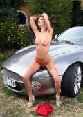 Topless model posing for gasoline