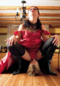 Domina in black boots sitting on slaves face