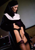 Sexy nuns in stockings get nasty with a dildo.