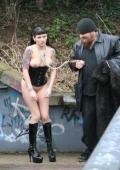 Hot gothic slut treated as a dog in a public bridge