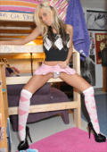 College teen girl poses in her argyle outfit