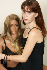 LOVE DOLL DENISA and a brunette chick in action