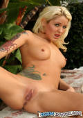 Jeska spreads her legs wide to show off her amazing tight shaved pussy