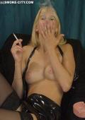 Girl in latex dress smoking