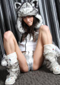 Model dressed as wolf in silver shiny spandex.