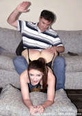 Luci's bottom is given a thorough spanking