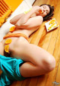 Girl messing with oranges