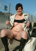 Nasty ugly streetwhore showing her wornout cunt